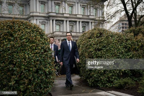 S Treasury Secretary Steven Mnuchin leaves a television interview outside of the West Wing of the White House on March 13 2020 in Washington DC...