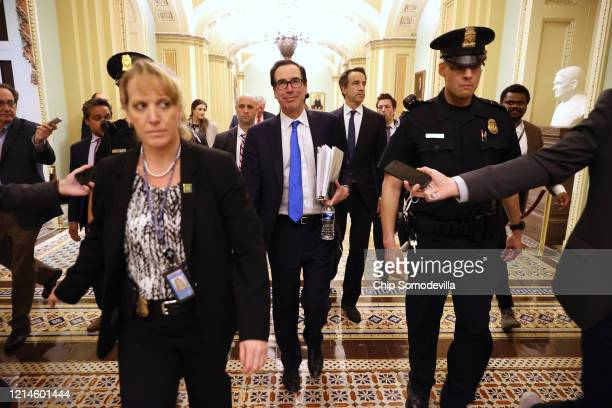 Treasury Secretary Steven Mnuchin leaves the offices of Minority Leader Charles Schumer as negotiations continue into the night on a $2 trillion...