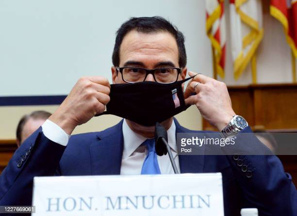 S Treasury Secretary Steven Mnuchin puts on his face mask after testifying before the House Small Business Committee at the US Capitol on July 17...