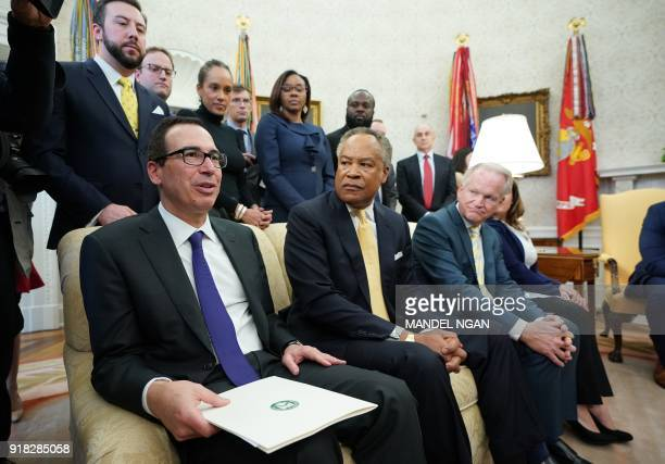 US Treasury Secretary Steven Mnuchin speaks during a working session on opportunity zones following the recently signed tax bill in the Oval Office...