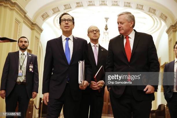 Treasury Secretary Steven Mnuchin talks briefly with reporters after arriving at the US Capitol with White House Director of Legislative Affairs Eric...