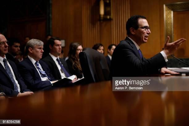 Treasury Secretary Steven Mnuchin testifies before the Senate Finance Committee on Capitol Hill on February 14 2018 in Washington DC Mnuchin...