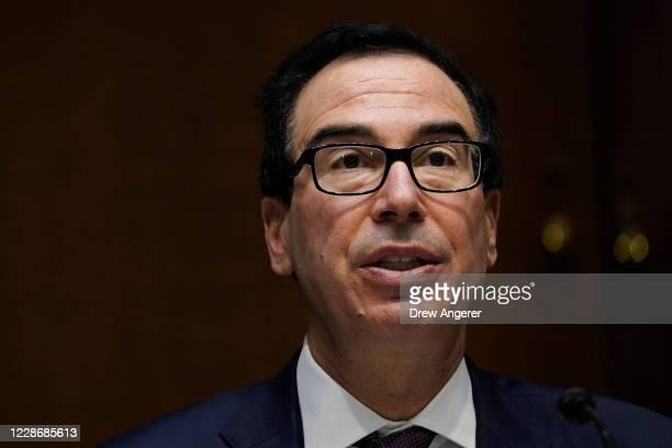S Treasury Secretary Steven Mnuchin testifies during a Senate Banking Committee hearing on Capitol Hill on September 24 2020 in Washington DC Mnuchin...