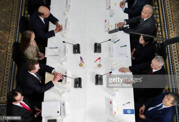 Treasury Secretary Steven Mnuchin, US Trade Representative Robert Lighthizer, unidentified interpreter, and Commerce Secretary Wilbur Ross take part...