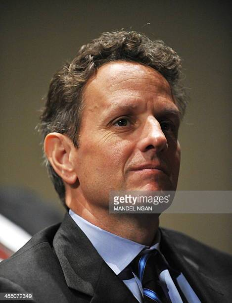 Treasury Secretary Tim Geithner listens as US President Barack Obama speaks during a Fathers Day event June 21 2010 at the THEARC Theater in...