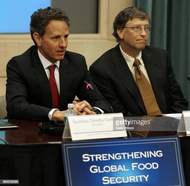 Treasury Secretary Timothy Geithner and Bill Gates cochairman of the Bill and Melinda Gates Foundation participate in an event at the Treasury...