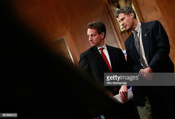 S Treasury Secretary Timothy Geithner confers with Assistant Secretary for Economic Policy Alan Krueger before Geithner testified before the Senate...