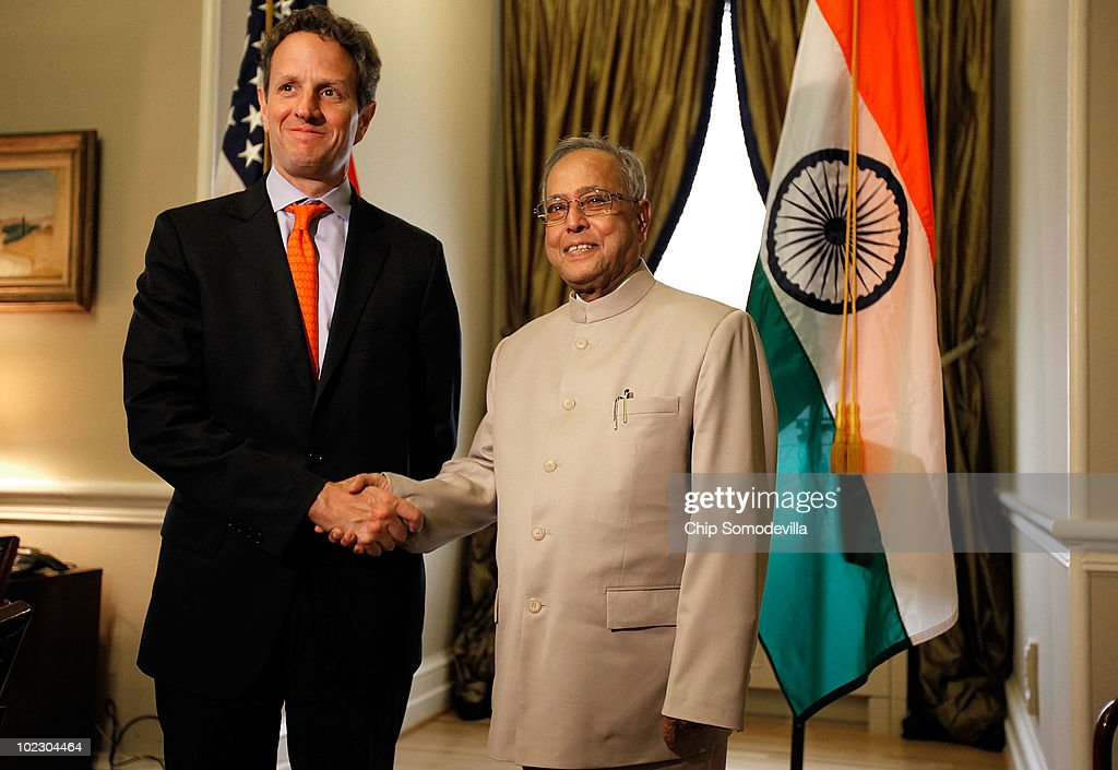 U.S. Treasury Secretary Timothy Geithner (L) poses for photographs with Indian Finance Minister Pranab Mukherjee before a meeting at the Treasury Department June 22, 2010 in Washington, DC. Mukherjee met separately today with Geithner and Secretary of State Hillary Clinton, potentially to discuss economic ties between the two countries ahead of President Barack Obama's trip to India in November.