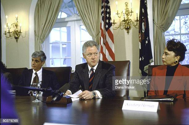 Treasury Secy Robert Rubin Pres Bill Clinton Labor Secy Alexis Herman during event w labor leaders in White House Cabinet Room