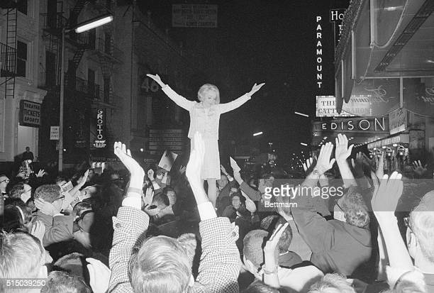 Treat for the Fans New York Frenzied fans 'fight' to catch postcard size photos which glamour queen Marlene Dietrich tosses them from atop limousine...