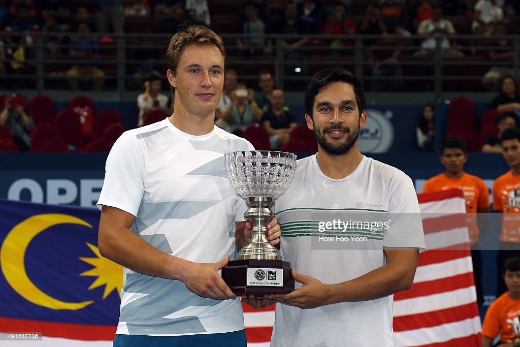 Treat Huey of Philippines and Henri Kontinen of Finland poses with their trophy after defeating Raven Klaasen of RSA and Rajeev Ram of USA in the double finals during ATP Malaysian Open at Bukit Jalil National Stadium on October 4, 2015 in Kuala Lumpur, Malaysia.