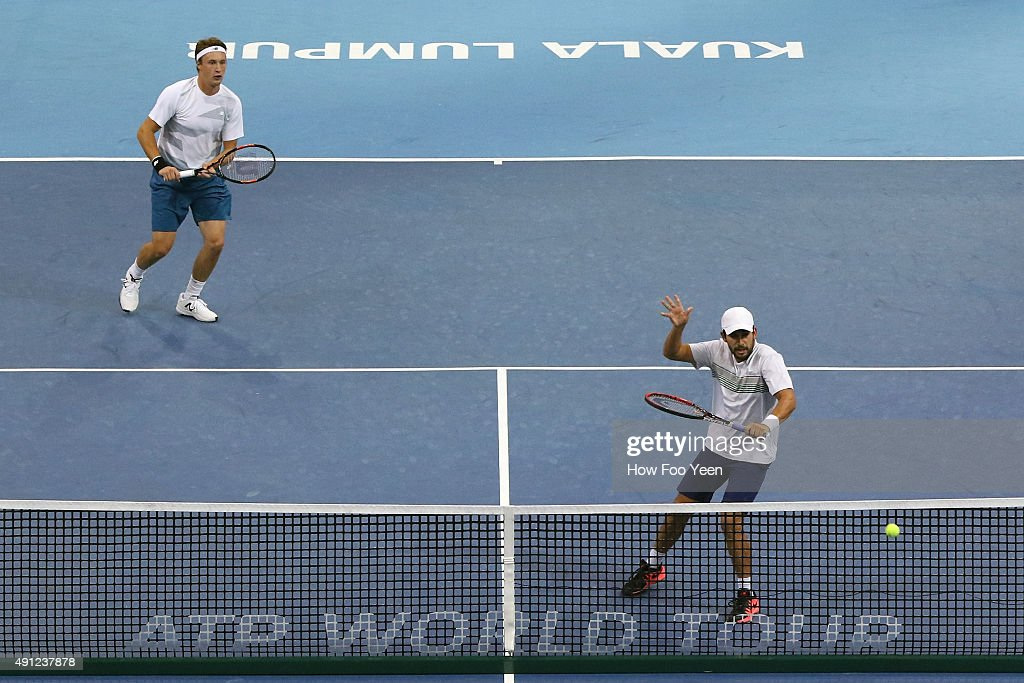 Treat Huey of Phillipines and Henri Kontinen of Finland competes Raven Klaasen of RSA and Rajeev Ram of USA during the 2015 ATP Malaysian Open at Bukit Jalil National Stadium on October 4, 2015 in Kuala Lumpur, Malaysia.