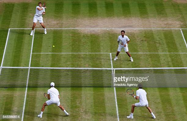 Treat Huey of Phillipines and partner Max Mirnyi of Belarus in action against PierreHugues Herbert and partner Nicolas Mahut in the mens' doubles...