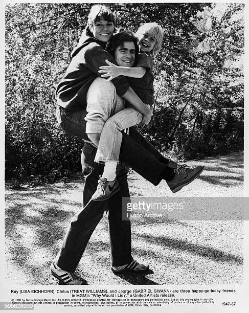 Treat Williams carries Lisa Eichhorn and Gabriel Swann in a scene from the MGM movie Why Would I Lie circa 1980