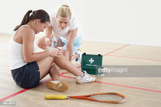 Treating Sports Injury on Squash Court