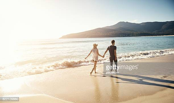 treating themselves to a beachside vacation - love emotion stock pictures, royalty-free photos & images