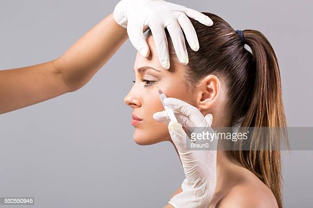 treatment with botox. - botox stock pictures, royalty-free photos & images