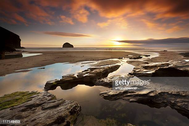 trebarwith strand sunset - newquay stock pictures, royalty-free photos & images