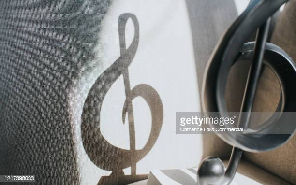 treble clef shadow - concert stock pictures, royalty-free photos & images