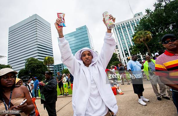 Trece Hall holds a bag of Skittles and a can of Arizona Iced Tea during the 10000 Hoodie March/Rally for Social Justice in Remembrance of Trayvon...
