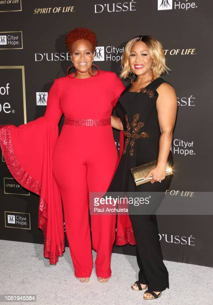 Trecina 'Tina' Campbell and Erica Campbell attend the City Of Hope Gala on October 11 2018 in Los Angeles California