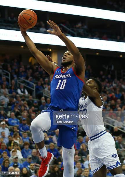 Tre'Darius McCallum of the DePaul Blue Demons attempts a shot as Myles Cale of the Seton Hall Pirates defends during the first half of a game at...