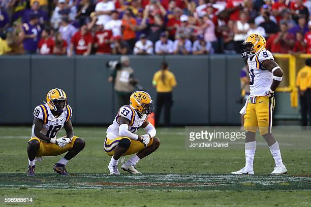 Tre'Davious White Jamal Adams and Rickey Jefferson of the LSU Tigers react after being defeated 1614 by the Wisconsin Badgers at Lambeau Field on...