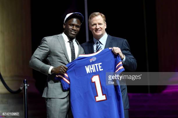 Tre'Davious White of LSU poses with Commissioner of the National Football League Roger Goodell after being picked overall by the Buffalo Bills during...