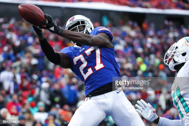 Tre'Davious White of the Buffalo Bills attempts to intercept the ball during the fourth quarter against the Miami Dolphins on December 17 2017 at New...