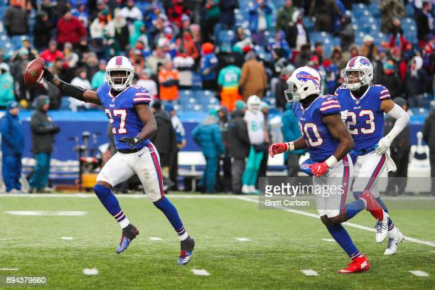 Tre'Davious White of the Buffalo Bills celebrates with teammates after a game winning interception against Miami Dolphins on December 17 2017 at New...