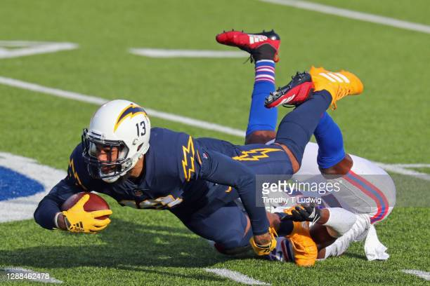 Tre'Davious White of the Buffalo Bills tackles Keenan Allen of the Los Angeles Chargers during the first quarter at Bills Stadium on November 29,...