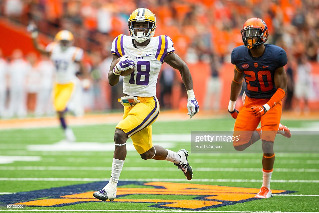 Tre'Davious White #18 of the LSU Tigers returns a punt for a touchdown to make the score 17-3 during the second half against the Syracuse Orange on September 26, 2015 at The Carrier Dome in Syracuse, New York. LSU defeats Syracuse 34-24.