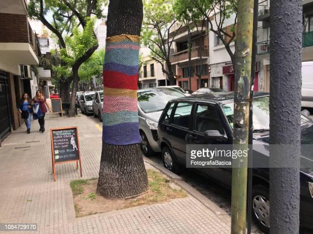 Tree bark covered with yarn design