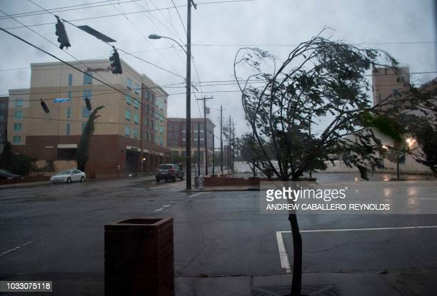 TOPSHOT A tree bends from the heavy rain and wind from Hurricane Florence in Wilmington North Carolina on September 14 2018 Florence smashed into the...