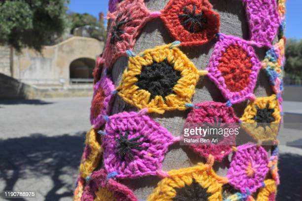 tree covered with crochet - rafael ben ari stock pictures, royalty-free photos & images