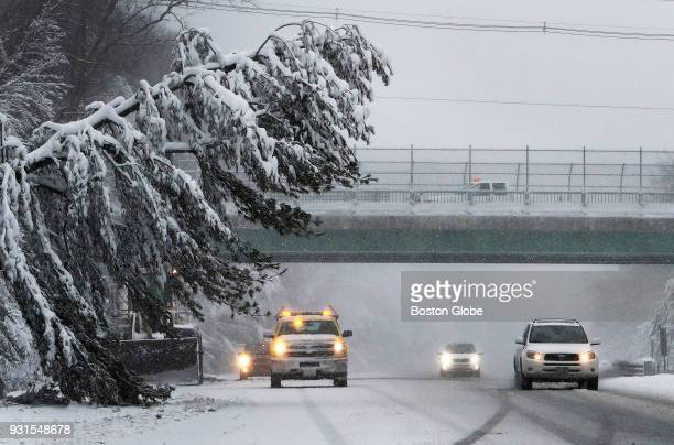A tree hangs over the road on Route 495 in Merrimac MA during the third nor'easter storm to hit the region in two weeks on March 13 2018