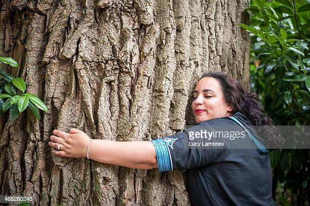 Tree hugging woman