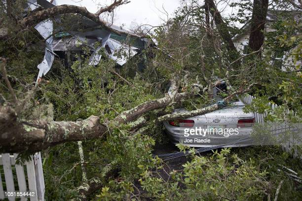 A tree lays on a home and car after hurricane Michael passed through the area on October 10 2018 in Panama City Florida The hurricane hit the Florida...