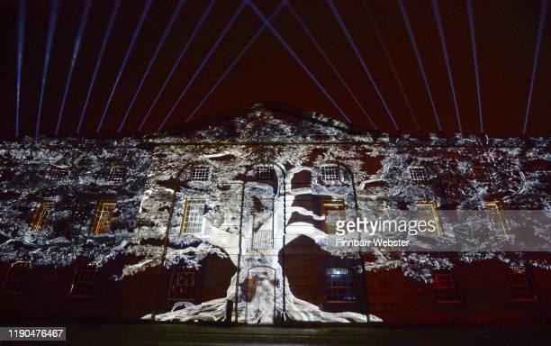 Tree of Memory by Spanish artist Xavi Bove illuminates a building at Royal William Yard on November 27 2019 in Plymouth England Illuminate is a free...