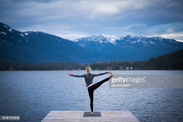 tree pose lakeside yoga - tree position stock photos and pictures