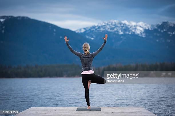 Tree pose lakeside yoga