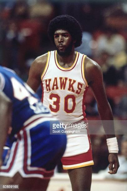 Tree Rollins of the Atlanta Hawks looks on during an NBA game circa 1980 in Atlanta Georgia NOTE TO USER User expressly acknowledges and agrees that...