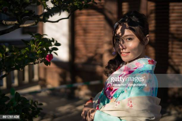 tree shadow on the face of young woman in kimono