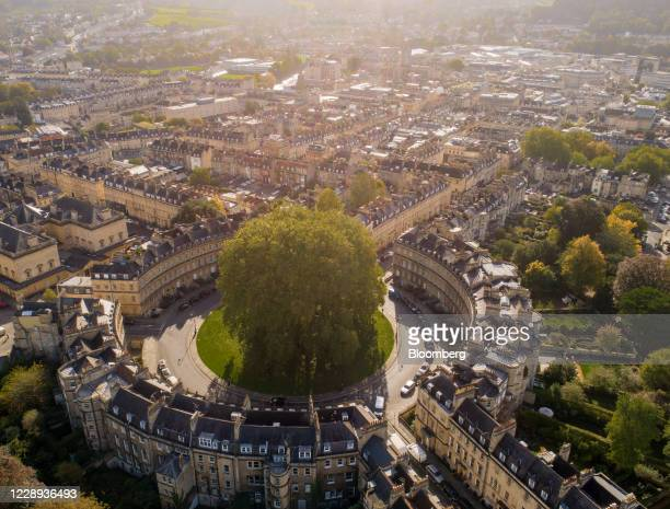 Tree stands surrounded by residential houses on The Circus in this aerial view in Bath, U.K., on Wednesday, Oct. 7, 2020. U.K. House prices rose at...