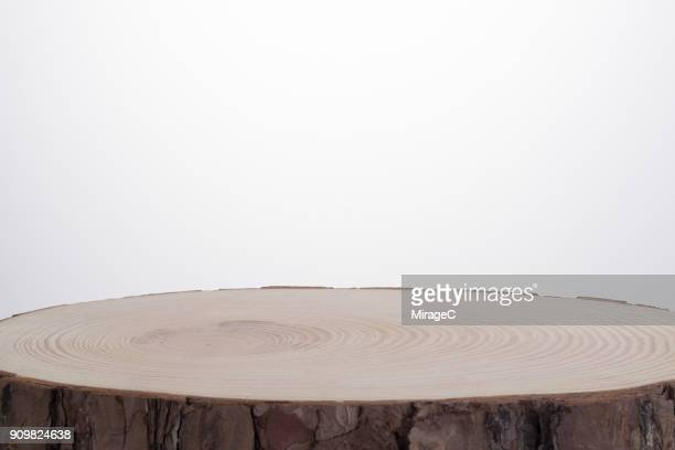 tree stump against white - tree stump stock pictures, royalty-free photos & images