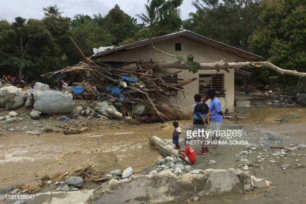 Tree trunks and debris washed away by flash floods are seen lodged in a damaged house in Sentani near the provincial capital of Jayapura, Indonesia's...