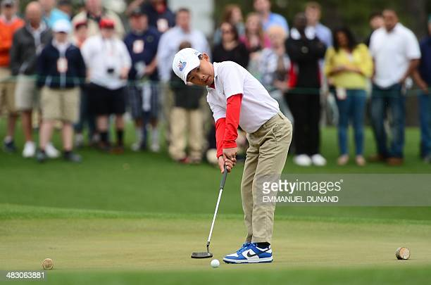 Treed Huang from Katy Texas putts during the National Finals of the 2014 Drive Chip and Putt Championships April 6 2014 at Augusta National Golf Club...