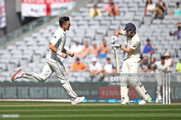 Treent Boult of New Zealand celebrates his wicket of Dawid Malan of England during day one of the First Test match between New Zealand and England at...