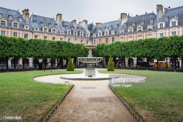 trees against buildings at le jardin du luxembourg in city - fountain stock pictures, royalty-free photos & images