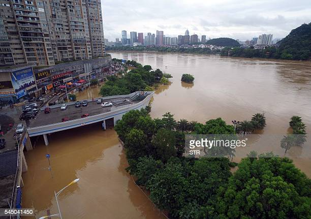 Trees along the Liujiang River are submerged by floodwater in Liuzhou south China's Guangxi Zhuang Autonomous Region on July 5 2016 Flooding in...